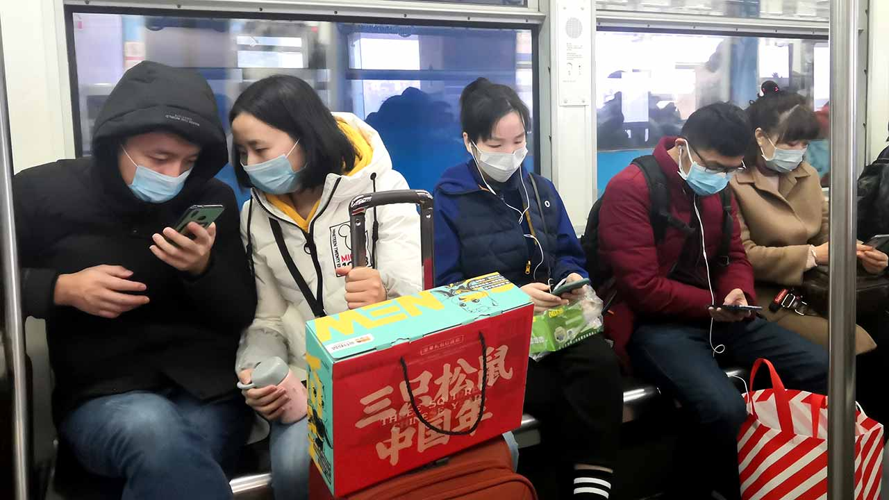 Commuters take precautions against the cornonavirus in the central Chinese city of Chinese of Chongqing on January 23, 2020. Source: Shutterstock