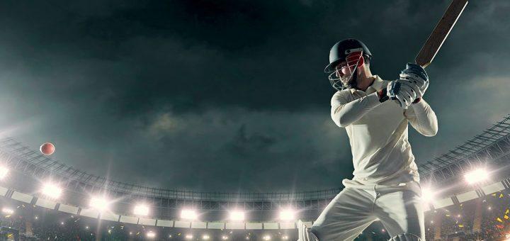 A cricket player hitting a ball for six runs.