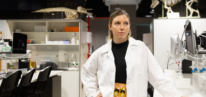 Surrounded by dinosaurs ... a female scientist