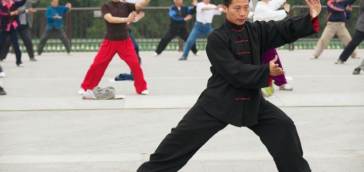 A man in Beijing, China practiises Tai Chi.
