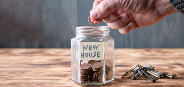 Placing coins in a jar to save for a new house. Inflation. Interest rates